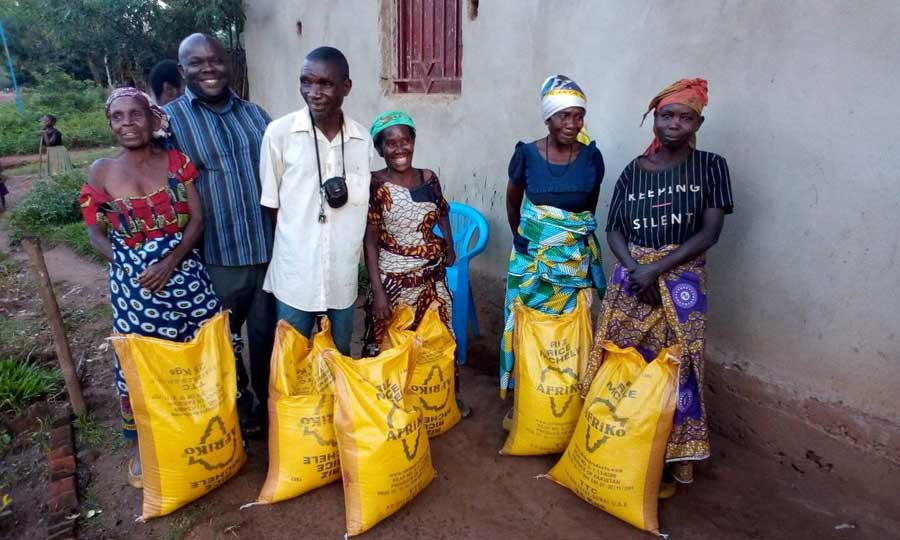 Group of people with large yellow bags of food