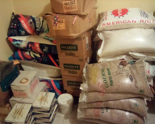 Bags of rice and boxes of supplies