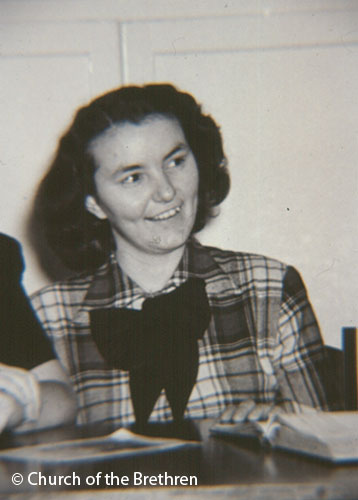 Black and white photo of Alma Long smiling
