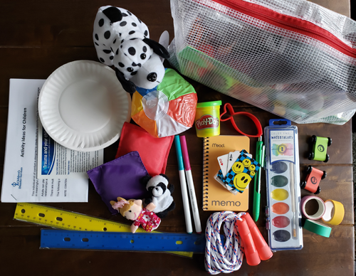 "Toys and art supplies making up a Children's Disaster Services ""kit of comfort"""