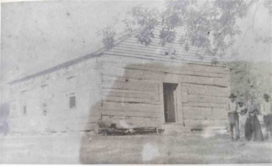 1800s photo of a log church