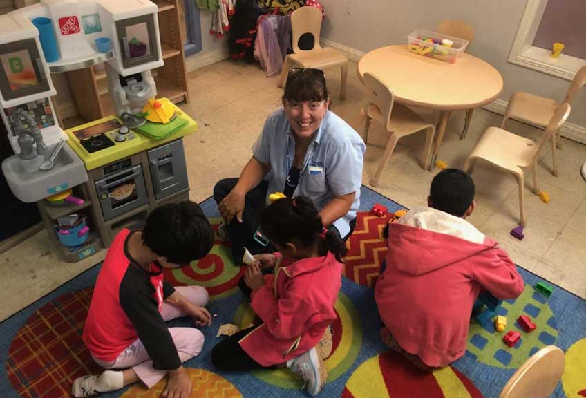 CDS volunteer Carolyn Neher with playing children