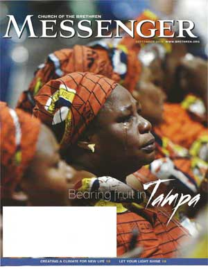Nigerian women wearing EYN fabric, one is crying