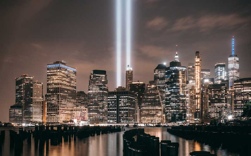 """New York City skyline at night with """"Tribute in Light"""" beams showing"""