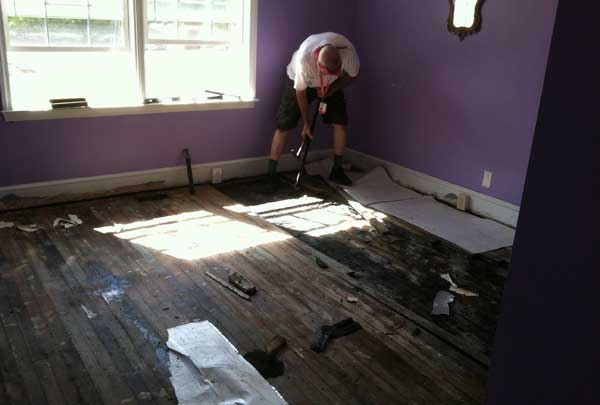 Volunteer tearing up a damaged floor in South Carolina.