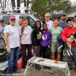 Disaster relief volunteers work on house damaged by hurricane Matthew