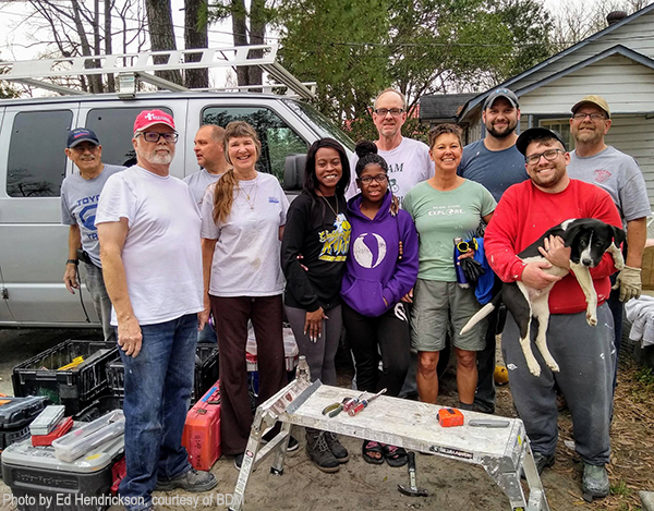 Disaster relief volunteers work on house damaged by hurricane Matthew