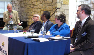 Russell Haitch moderates a faculty panel