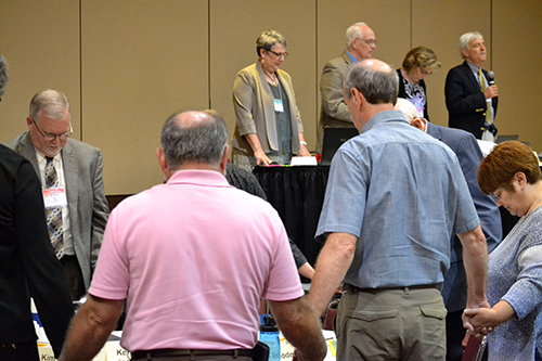 Standing Committee holds prayer with the leaders of the Annual Conference agencies