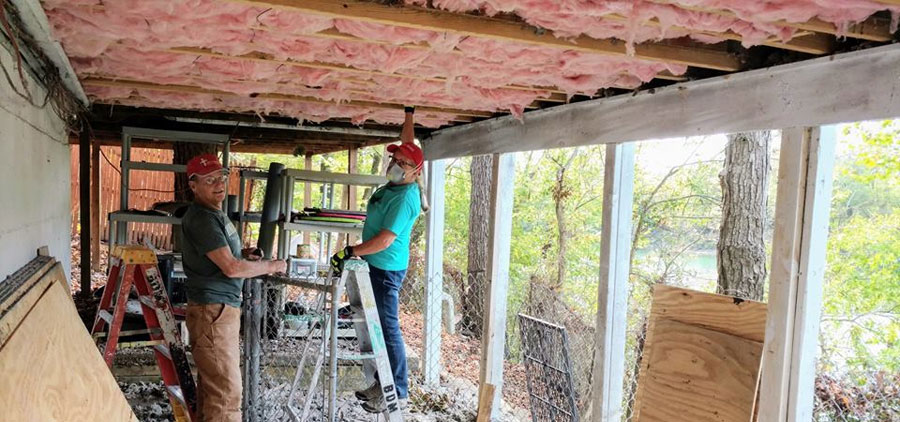 rethren Disaster Ministries volunteers replace insulation on a damaged house