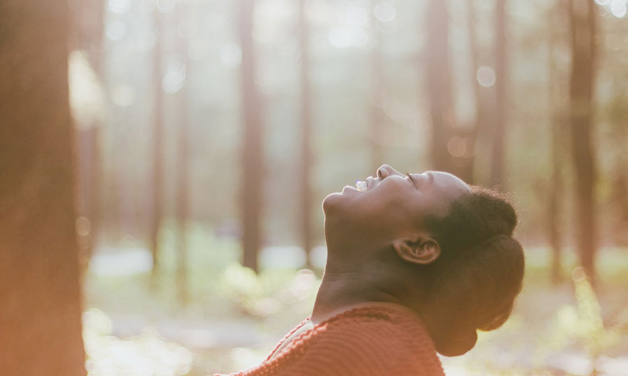 Woman rejoicing in the woods